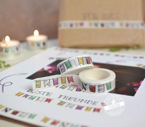 buntes Tixo mit Wimpeln zum verzieren von Geschenken, Alben und Gästebüchern