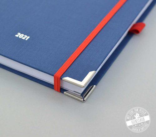 Taschenkalender in blau und rot