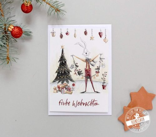 Weihnachtskarte zum Versenden guter Wünsche mit weihnachtlichen Hasenmotiven