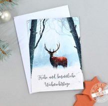Weihnachtskarte mit Hirsch im Winterwald