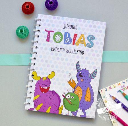 Schulkind Notizbuch mit bunten Monstern Vokalbheft